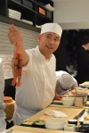 "Nakazawa showing us the live prawns before he beheads them, saying happily, ""Sayounara!"""
