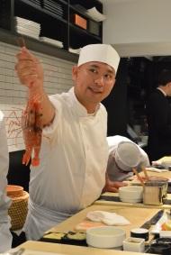 "Nakazawa showing us the live prawns before he beheads them, saying happily, ""Sayounara!"""