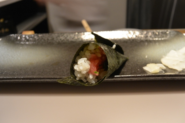 Tuna hand roll with chopped shiso leaf